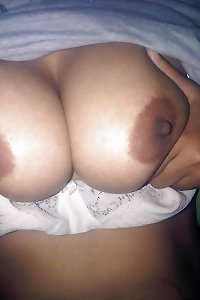 Indian elder wife displaying globes